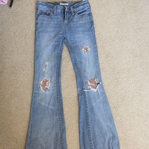 Free People Distressed Low Rose Flared Jeans